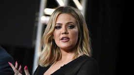 """FILE - In this Jan. 6, 2016, file photo, Khloe Kardashian participates in the panel for """"Kocktails with Khloe"""" at the FYI 2016 Winter TCA in Pasadena, Calif. Kardashian is calling her sister's robbery on Oct. 3, in Paris """"a wake up call for everybody"""" but is pushing back against criticism that Kim Kardashian West had been too public in displaying her wealth. (Photo by Richard Shotwell/Invision/AP, File)"""