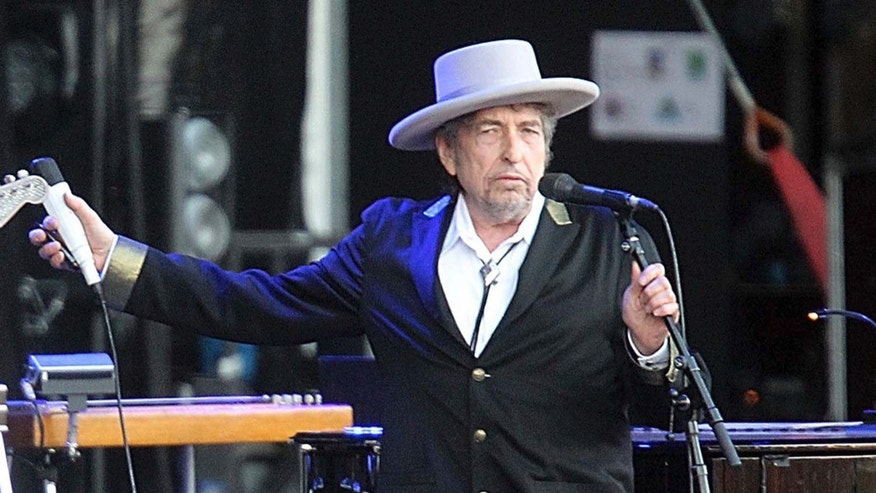 "This July 22, 2012, file photo shows U.S. singer-songwriter Bob Dylan performing onstage at ""Les Vielles Charrues"" Festival in Carhaix, western France."