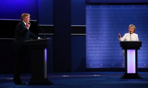 Republican U.S. presidential nominee Donald Trump and Democratic nominee Hillary Clinton speak at the same time as they discuss an issue during their third and final 2016 presidential campaign debate at UNLV in Las Vegas, Nevada, U.S., October 19, 2016. REUTERS/Carlos Barria   TPX IMAGES OF THE DAY - RTX2PLZM