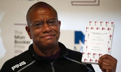 """Writer Paul Beatty poses for the media with his book """"The Sellout"""" during a photocall for the 6 shortlisted authors for the Man Booker Prize for fiction in London, Monday, Oct. 24, 2016. This will be the third year the £50,000 (61,000 US$), prize has been open to any writer, writing originally in English and published in the UK, irrespective of nationality.(AP Photo/Alastair Grant)"""