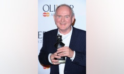"""FILE - This March 13, 2011 file photo shows British director Howard Davies at the Olivier Awards in London. Award-winning British theater director Howard Davies has died at the age of 71.His family said in a statement Wednesday, Oct. 26, 2016 that Davies died of cancer Tuesday. He was active for many years in both London and New York, directing a series of well-received plays. In Britain he won the coveted Best Director Laurence Olivier Awards three times for his work on """"The Iceman Cometh,"""" """"All My Sons"""" and """"The White Guard."""" (Ian West/PA via AP, file)"""