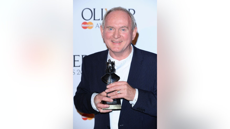 This March 13, 2011 file photo shows British director Howard Davies at the Olivier Awards in London.