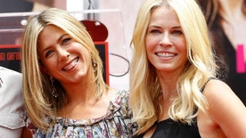 Actress Jennifer Aniston (L) poses with Chelsea Handler after her hand and footprint ceremony at the Grauman's Chinese Theatre in Hollywood, California July 7, 2011.