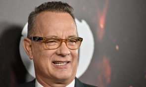 """Tom Hanks arrives at a special screening of """"Inferno"""" at the Directors Guild of America Theatre on Tuesday, Oct. 25, 2016, in Los Angeles. (Photo by Jordan Strauss/Invision/AP)"""