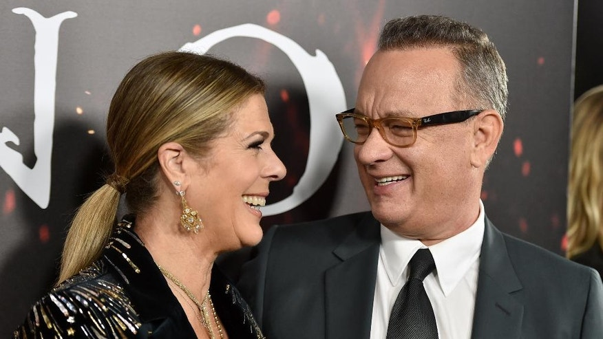 """Rita Wilson, left, and Tom Hanks arrive at a special screening of """"Inferno"""" at the Directors Guild of America Theatre on Tuesday, Oct. 25, 2016, in Los Angeles."""