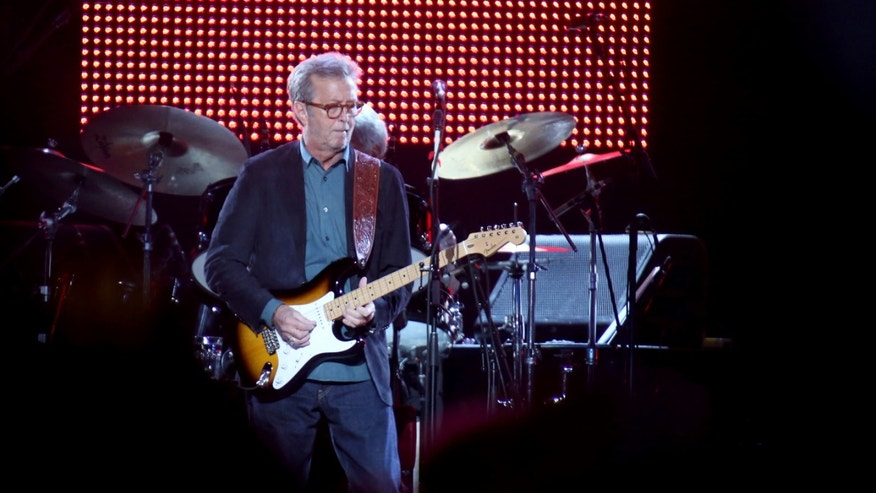 "Eric Clapton, center, performs during his ""70th Birthday Celebration"" concert at Madison Square Garden on Friday, May 1, 2015, in New York. (Luiz C. Ribeiro/Invision/AP)"