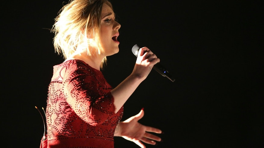 In this Feb. 15, 2016, file photo, Adele performs at the 58th annual Grammy Awards in Los Angeles.