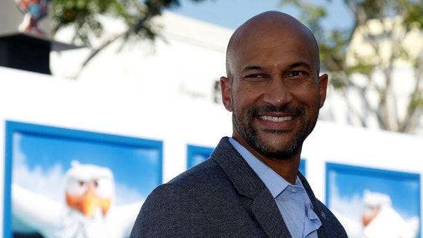 """Cast member Keegan-Michael Key, who gives voice to the character of Wolf Pack, poses at the premiere of the animated movie """"Storks"""" in Los Angeles, California U.S., September 17, 2016.   REUTERS/Mario Anzuoni - RTSO7BR"""