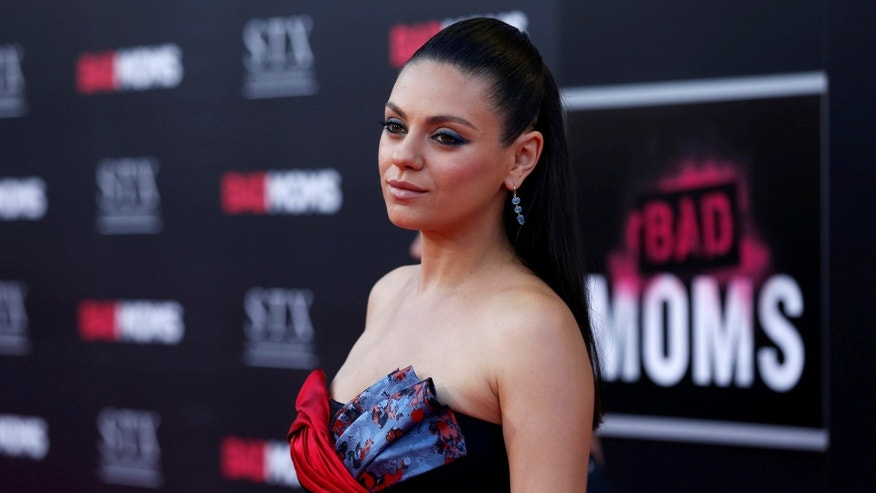 "Cast member Mila Kunis poses at the premiere of ""Bad Moms"" in Los Angeles, California U.S., July 26, 2016."