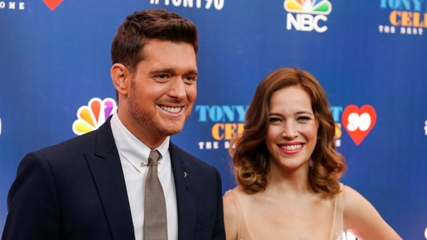 "Singer Michael Buble (L) and Luisana Lopilato walk on the red carpet for ""Tony Bennett Celebrates 90: The Best Is Yet to Come"" at the legendary Radio City Music Hall in New York, U.S., September 15, 2016. REUTERS/Eduardo Munoz - RTSNYN3"
