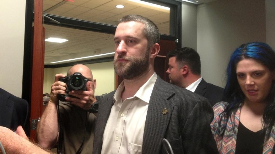 "In this May 29, 2015, file photo, television actor Dustin Diamond, center, leaves court in Port Washington, Wisc., after being convicted of two misdemeanors stemming from a barroom fight on Christmas Day 2014. Diamond, of ""Saved by the Bell"" fame, is set to be sentenced Thursday, June 25, 2015."