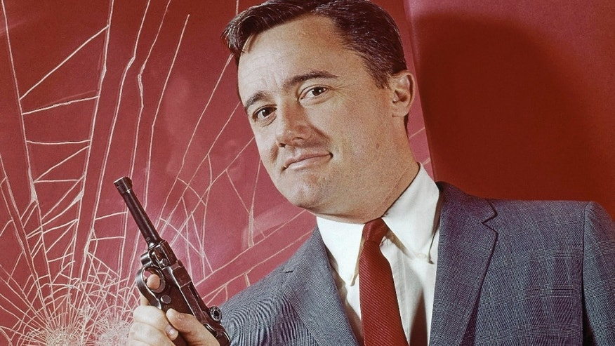 "Actor Robert Vaughn reaches out to touch on his newly unveiled star on the Hollywood Walk of Fame during ceremonies honoring Vaughn July 27 in Hollywood. Vaughn is best known for his role as Napoleon Solo on the television series "" The Man From U.N.C.L.E."" and is also celebrating the release of his 100th motion picture, ""BASEketball"" which opens in the United States July 31.  RMP/ME - RTRFX5S"