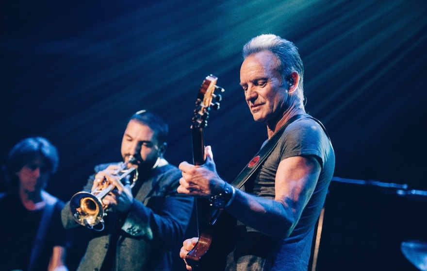 In this Saturday, Nov. 12, 2016 photo provided by Universal Music France, British musician Sting performs on stage at the Bataclan concert hall in Paris, France, Saturday, Nov. 12, 2016. A concert by British pop legend Sting is marking the reopening of the Paris' Bataclan concert hall one year after suicidal jihadis turned it into a bloodbath and killed 90 revelers. (Boris Allin/Universal Music France via AP) MANDATORY CREDIT