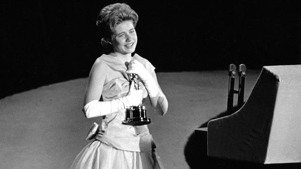 """Patty Duke, 16, accepts the Oscar as best supporting actress for her work in """"The Miracle Worker"""" at the annual Academy Awards in Santa Monica, Calif., on April 8, 1963.   (AP Photo)"""