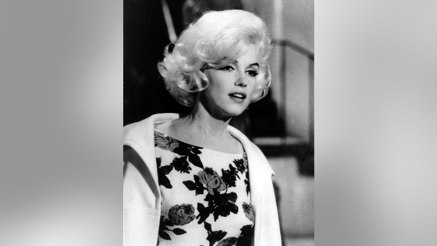 """This April 1962 file photo shows actress Marilyn Monroe on the set of her last movie, """"Something's Got To Give,"""" in Los Angeles."""