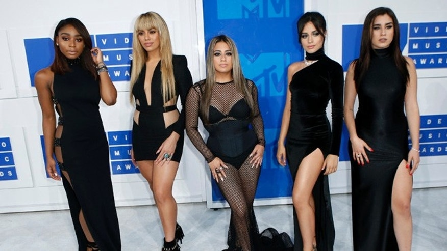 Fifth Harmony member Lauren Jauregui (far right) has come out as bisexual and criticized Trump supporters.