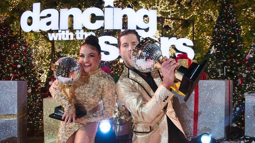 "In this Nov. 22, 2016 photo released by ABC, Laurie Hernandez, left, and Val Chmerkovskiy celebrate after winning the 23rd season of the celebrity dance competition series, ""Dancing With The Stars,"" in Los Angeles."