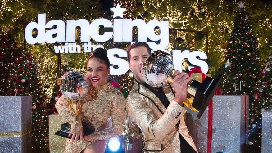 Laurie Hernandez and Val Chmerkovskiy celebrate after winning the 23rd season of 'Dancing With The Stars.'