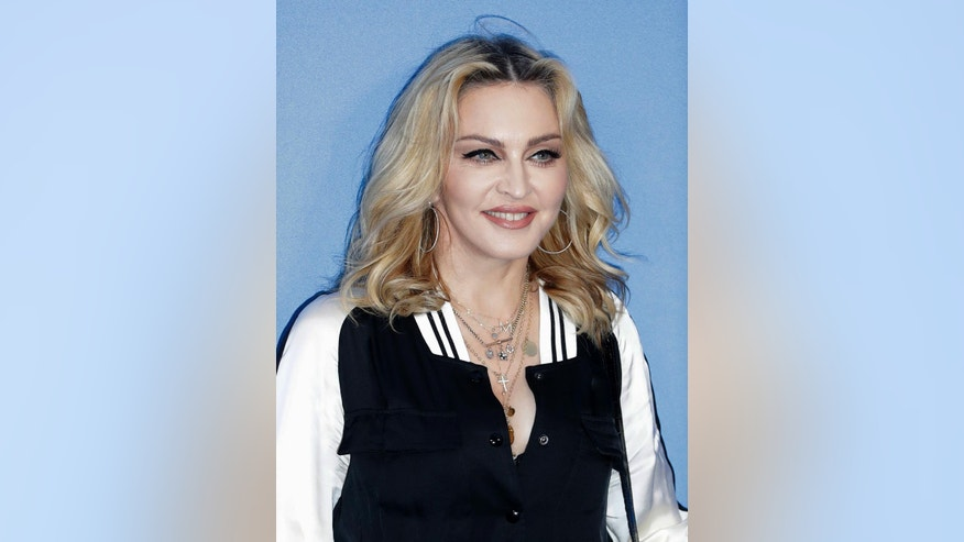 """In this Sept. 15, 2016 file photo, musician Madonna poses for photographers at the World premiere of the Beatles documentary, """"Eight Days a Week - The Touring Years,"""" in London. (AP Photo/Kirsty Wigglesworth, File)"""