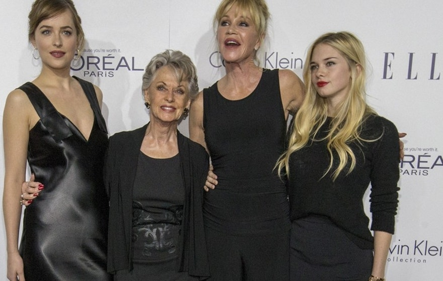 Actress Dakota Johnson (L) poses with her mother Melanie Griffith (2nd R), her sister Stella Banderas (R) and her grandmother Tippi Hedren at the 22nd annual ELLE Women in Hollywood Awards in Los Angeles, California October 19, 2015.