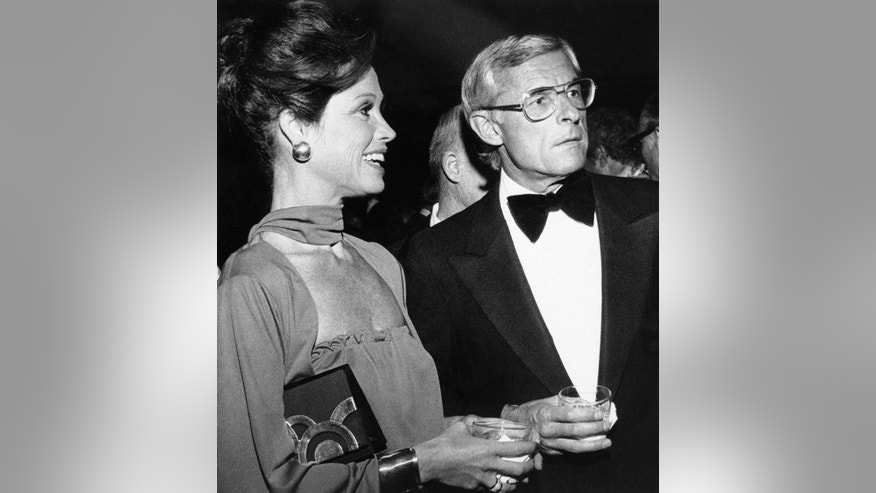 In this Nov. 7, 1976, file photo, Mary Tyler Moore attends a reception in Los Angeles with her husband, Grant Tinker, before she was honored by the Hollywood chapter of the National Academy of Television Arts and Sciences for outstanding achievement in the industry.