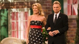"Vanna White, a South Carolina native, and Pat Sajak, co-hosts of  the television show ""Wheel of Fortune"", greet the crowd on the set in North Charleston, S.C., Saturday, Jan. 12, 2007. It's the first time the show, now in its 24th season and seen in syndication by an estimated 46 million fans each week, has taped in South Carolina. (AP Photo/Alice Keeney)"