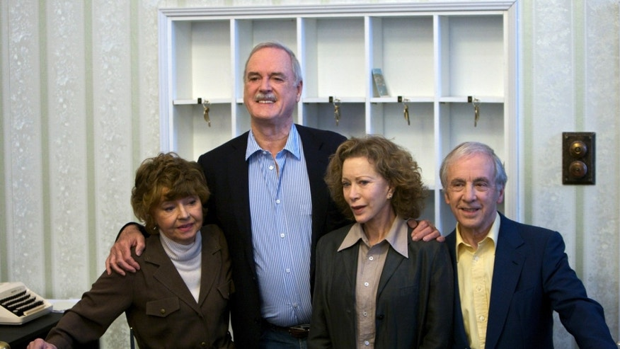"In this Wednesday, May 6, 2009 file photo, the cast of TV comedy series Fawlty Towers, from left, Prunella Scales, John Cleese, Connie Booth and Andrew Sachs reunite to celebrate the 30th anniversary of the TV show and mark a special programe ""Fawlty Towers: Re-opened"" at The Naval and Military Club, London."