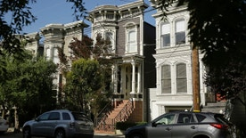 """FILE - This May 27, 2016, file photo, shows a Victorian home, center, in San Francisco, made famous by the television show """"Full House."""" The home was sold to producer Jeff Franklin, who created the show. The veteran TV producer bought the 3-bedroom Victorian, which was on the market for over $4 million, in August. The realtor had declined to say at the time who bought the home, which is in San Francisco's Lower Pacific Heights neighborhood. The home's exterior was used as the Tanner family's residence in the original show. (AP Photo/Eric Risberg,File)"""
