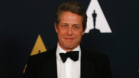 Actor Hugh Grant arrives at the 8th Annual Governors Awards in Los Angeles, California, U.S., November 12, 2016.  REUTERS/Mario Anzuoni - RTX2TE9H