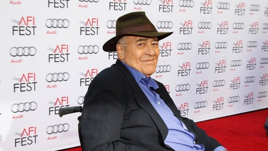 "Italian director Bernardo Bertolucci smiles during an interview as he arrives for a gala screening of his film ""The Last Emperor"" in 3D at the AFI Fest 2013 in Hollywood, California, November 10, 2013. REUTERS/Fred Prouser (UNITED STATES - Tags: ENTERTAINMENT) - RTX158LK"