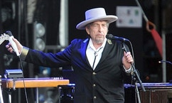 "FILE - This July 22, 2012, file photo shows U.S. singer-songwriter Bob Dylan performing onstage at ""Les Vieilles Charrues"" Festival in Carhaix, western France. Dylan won the 2016 Nobel Prize in literature, announced Thursday, Oct. 13, 2016. (AP Photo/David Vincent, File)"