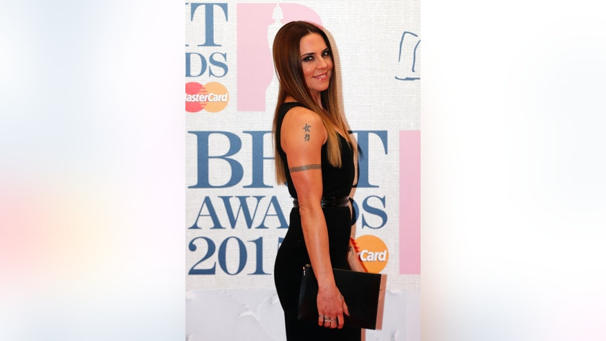 Former Spice Girl Melanie Chisholm (Sporty Spice) arrives for the BRIT music awards at the O2 Arena in Greenwich, London, February 25, 2015.