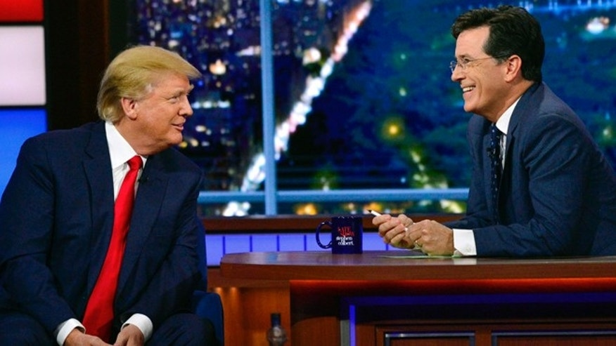 "In this photo provided by CBS, Republican presidential candidate Donald Trump, left, joins host Stephen Colbert on the set of ""The Late Show with Stephen Colbert,"" Tuesday, Sept. 22, 2015, in New York. (John Paul Filo/CBS via AP) MANDATORY CREDIT; NO ARCHIVE; NO SALES; NORTH AMERICAN USE ONLY"