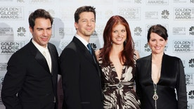 """FILE - In this Jan. 16, 2006 file photo, cast members from the comedy series """"Will & Grace,"""" from left, Eric McCormack, Sean Hayes, Debra Messing and Megan Mullally, pose backstage after making an award presentation at the 63rd Annual Golden Globe Awards in Beverly Hills, Calif. Mullally hinted in an interview with PrideSource published on Dec. 7, 2016, that a revival of the series could be in the works. (AP Photo/Reed Saxon, File)"""