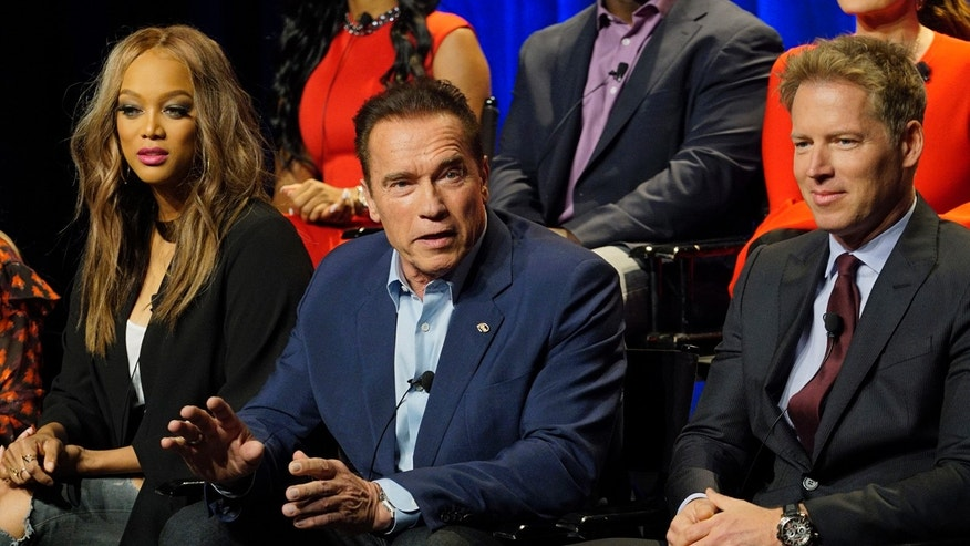 "In this Friday, Dec. 9, 2016 photo provided by NBC, Tyra Banks, from left, Arnold Schwarzenegger, Patrick Knapp Schwarzenegger attend a press junket for ""The New Celebrity Apprentice,"" in Los Angeles."
