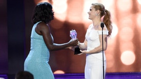 Amy Adams, right, presents Viola Davis with the #SEEHER award at the 22nd annual Critics' Choice Awards at the Barker Hangar on Sunday, Dec. 11, 2016, in Santa Monica, Calif. (Photo by Chris Pizzello/Invision/AP)