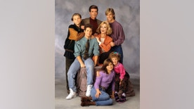 """This 1991 image released by ABC shows the cast of """"Growing Pains,"""" standing from left, Leonardo DiCaprio, Alan Thicke and Jeremy Miller, with Kirk Cameron, seated center left, and Joanna Kerns, seated center right, and Tracey Gold, seated left on floor and Ashley Johnson. Thicke, who played Dr. Jason Seaver, a psychiatrist and ideal TV dad, died on Tuesday, Dec. 13, 2016. He was 69. (Bob D'Amico/ABC via AP)"""