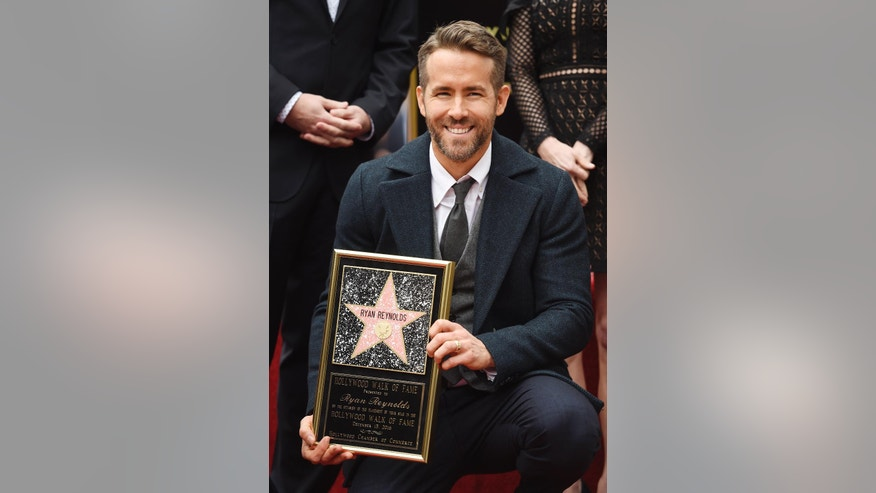 Actor Ryan Reynolds poses after receiving a star on the Hollywood Walk of Fame on Thursday, Dec. 15, 2016, in Los Angeles (Photo by Chris Pizzello/Invision/AP)