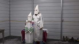 "A female and male member of the Virgil Griffin White Knights, a group that claims affiliation with the Ku Klux Klan, pose for a photograph in their robes ahead of a cross lighting ceremony at a private farm house in Carter County, Tennessee July 4, 2015. The Ku Klux Klan, which had about 6 million members in the 1920s, now has some 2,000 to 3,000 members nationally in about 72 chapters, or klaverns, according to the Southern Poverty Law Center, an organization that monitors extremist groups.  REUTERS/Johnny Milano  PICTURE 29 OF 34 FOR WIDER IMAGE STORY ""INSIDE THE KU KLUX KLAN"" SEARCH ""MILANO KKK"" FOR ALL PICTURES - RTX1KJWX"