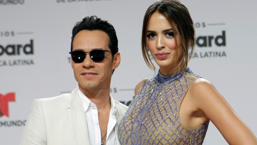 In this April 28, 2016, file photo, singer Marc Anthony and his wife Shannon de Lima arrive at the Latin Billboard Awards in Coral Gables, Fla.