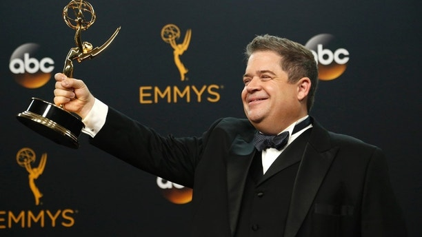 """Writer Patton Oswalt poses backstage with his award for Outstanding Writing For A Variety Special for """"Patton Oswalt: Talking For Clapping"""" at the 68th Primetime Emmy Awards in Los Angeles, California U.S., September 18, 2016."""