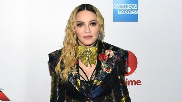 Madonna attends the 11th annual Billboard Women in Music honors at Pier 36 on Friday, Dec. 9, 2016, in New York. Billboard Women in Music 2016 will air Dec. 12 on Lifetime. (Photo by Evan Agostini/Invision/AP)
