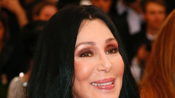 """Cher arrives at the Metropolitan Museum of Art Costume Institute Gala 2015 celebrating the opening of """"China: Through the Looking Glass,"""" in Manhattan, New York May 4, 2015.   REUTERS/Lucas Jackson - RTX1BJWA"""