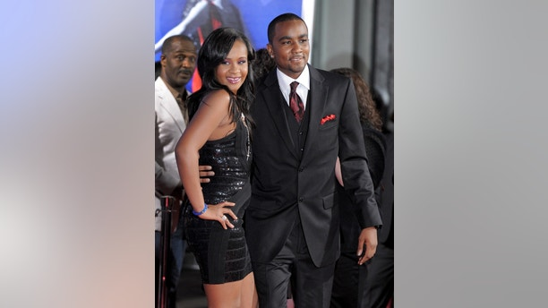 "FILE - In this Aug. 16, 2012, file photo, Bobbi Kristina Brown, left, and Nick Gordon attend the Los Angeles premiere of ""Sparkle"" at Grauman's Chinese Theatre in Los Angeles. The man Whitney Houston's daughter calls her husband says he is looking for permission from Brown's family to visit her in the hospital. Gordon said in a statement through his lawyers Randy Kessler and Joe Habacy on Wednesday night, Feb. 18, 2015, that he hopes his request will be granted. The 21-year-old Bobbi Kristina has been ""fighting for her life"" at Emory University Hospital in Atlanta since she was found in her bathtub face-down and responsive on Jan. 31. (Photo by Jordan Strauss/Invision/AP, File)"