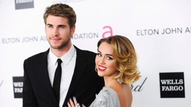 Singer Miley Cyrus (R) and actor Liam Hemsworth arrive at the 20th annual Elton John AIDS Foundation Academy Awards Viewing Party in West Hollywood, California February 26, 2012. REUTERS/Gus Ruelas (UNITED STATES - Tags: ENTERTAINMENT) (OSCARS-PARTIES) - RTR2YJ7I
