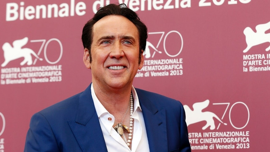 "Actor Nicolas Cage poses during a photocall for the movie ""Joe"", directed by David Gordon Green, during the 70th Venice Film Festival in Venice August 30, 2013."