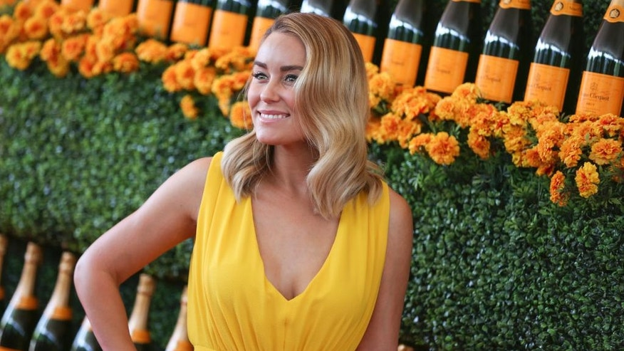 Lauren Conrad arrives at the Veuve Clicquot Polo Classic at Will Rogers State Historic Park in Pacific Palisades, Calif.