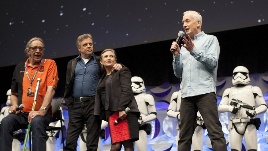 "Original ""Star Wars"" cast members Peter Mayhew (L), Mark Hamill, Carrie Fisher and Anthony Daniels (R) appear at the kick-off event of the Star Wars Celebration convention in Anaheim, California, April 16, 2015. The Star Wars Celebration runs through April 19 at the Anaheim Convention Center.  REUTERS/David McNew - RTR4XNYR"