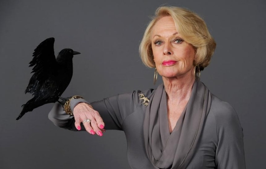 Tippi%20Hedren%20posing%20with%20a%20prop%20bird.%20Photo%20courtesy%20of%20Associated%20Press.