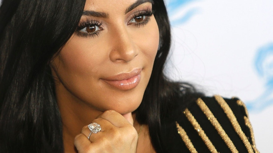 FILE - In this June 24, 2015 file photo, American TV personality Kim Kardashian attends the Cannes Lions 2015, International Advertising Festival in Cannes, southern France.